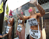 Naked Protesters glued to the window at H&M Oxford Street<br /> Extinction Rebellion demonstrators hold a Redress the Injustice day of protest around Central London, opposing the fashion industry's many human, animal and environmental injustices. September 9th 2020<br /> CAP/ROS<br /> ©ROS/Capital Pictures