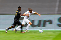 LOS ANGELES, CA - OCTOBER 25: Emiliano Insua #3 of the Los Angeles Galaxy moves past Jose Cifuentes #11 of LAFC battles during a game between Los Angeles Galaxy and Los Angeles FC at Banc of California Stadium on October 25, 2020 in Los Angeles, California.