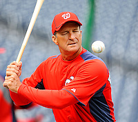2 April 2011: Washington Nationals Manager Jim Riggleman warms up his infielders prior to a game against the visiting Atlanta Braves at Nationals Park in Washington, District of Columbia. The Nationals defeated the Braves 6-3 in the second game of their season opening series. Mandatory Credit: Ed Wolfstein Photo