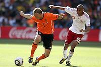 Dirk Kuyt of Holland and Simon Poulsen of Denmark