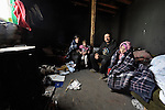 Arbanac Sofija and her 3-year old daughter Caka (left), along with her husband Vita Stankovic and their 5-year old daughter Rada, huddle in early 2012 inside their meager home in a Roma settlement in Belgrade, Serbia. In the middle of a deadly cold spell, they have stayed warm with help from blankets provided by Church World Service. The poor family has been told it will be evicted by city officials in March 2012 to make way for new high-rise office buildings.  In April 2012, the Serbian Orthodox family was forcibly evicted from the city center and given a metal shipping container in Makis, at the edge of Belgrade, where they could live. After several weeks, they were evicted from the shipping container because of Stankovic's repeated fights with his neighbors, and at the end of 2012 lived in an informal Roma squatter settlement in nearby Palilula. In 2009, they had been evicted from another settlement in Belgrade..