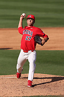 Dawson Netz (27) of the Arizona Wildcats pitches against the UCLA Bruins at Jackie Robinson Stadium on March 20, 2021 in Los Angeles, California. Arizona defeated UCLA, 7-3. (Larry Goren/Four Seam Images)