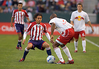 Red Bulls Mid. Amando Guevara and Chivas USA Mid. battle for a loose ball during a 0-0 tie between Chivas USA vs New York Red Bulls in a MLS game at The Home Depot Center in Carson, California Saturday, April, 29, 2006.