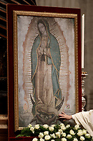 Papa Francesco tocca un dipinto della Madonna di Guadalupe, patrona dell'America Latina, durante la celebrazione di una Messa in occasione della festa della stessa nella Basilica di San Pietro in Vaticano, 12 dicembre 2017. <br /> Pope Francis touches a painting depicting the of Our Lady of Guadalupe, (Madonna di Guadalupe) patroness of Latin America, during a mass for her feast n Saint Peter's Basilica at the Vatican on December 12, 2017.<br /> UPDATE IMAGES PRESS/Isabella Bonotto<br /> <br /> STRICTLY ONLY FOR EDITORIAL USE