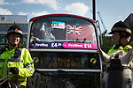"""© Joel Goodman - 07973 332324 . 22/08/2015 . Manchester , UK . Demonstrators are driven away on a coach . Far-right nationalist group , """" North West Infidels """" and Islamophobic , anti-Semitic and white supremacist supporters , hold a rally in Manchester City Centre . Photo credit : Joel Goodman"""