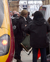 Brad Pitt's double gets off  the train from London to start shooting on War Z Film film set in Glasgow..Picture: Universal News And Sport (Scotland). 16 August 2011. www.unpixs.com..