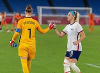 YOKOHAMA, JAPAN - JULY 30: Sari van Veenendaal #1 of Netherlands and Julie Ertz #8 of the USWNT react during a game between Netherlands and USWNT at International Stadium Yokohama on July 30, 2021 in Yokohama, Japan.