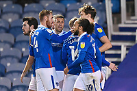 Sean Raggett of Portsmouth (20)  right is congratulated on scoring the first goal by Captain Tom Naylor of Portsmouth during Portsmouth vs Oxford United, Sky Bet EFL League 1 Football at Fratton Park on 24th November 2020