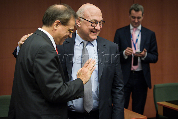 Greek Finance Minister Gikas Chardouvelis (L) and French Foreign Minister Michel Sapin   at the start of a Eurogroup with European Finance Ministers meeting at EU council headquarters in Brussels, Belgium on 26.01.2015 The Eurogroup's meeting focus on Greece, after  leftist anti-bailout party SYRIZA won parliamentary elections by Wiktor Dabkowski