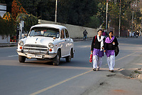 India, Dehradun.  Two Young Women Wearing a Shalwar, Kameez, and Dupatta.  Shalwar = loose trousers; kameez = long, loose shirt; dupatta = scarf-like garment covering the head or shoulders.