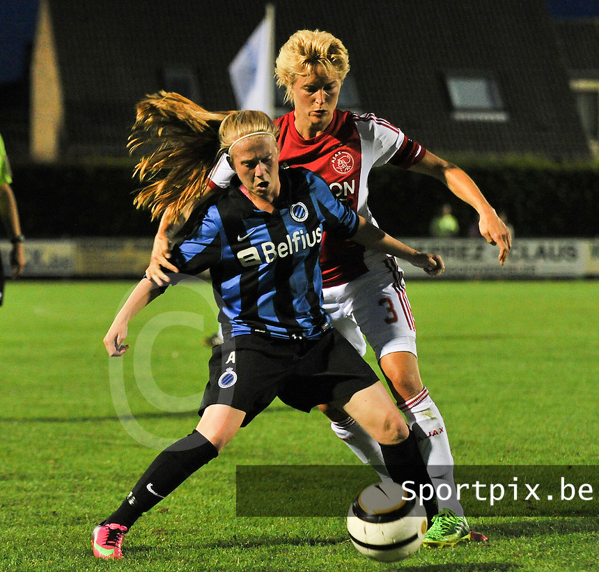 20130830 - VARSENARE , BELGIUM : Ajax' Daphne Koster pictured in a duel with Brugge's Silke Demeyere (left)  during the female soccer match between Club Brugge Vrouwen and Ajax Amsterdam Dames , of the first matchday in the BENELEAGUE competition. Friday 30 August 2013. PHOTO DAVID CATRY