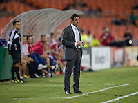 D.C. United head coach Ben Olsen watches his team at RFK Stadium in Washington, DC.  D.C. United defeated the Chicago Fire, 4-2.
