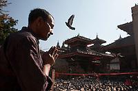 A Nepali man prays in front of a destroyed temple at Kathmandu Durbar Square, Kathmandu, Nepal. May 03, 2015