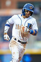 Andrew Velazquez of the Durham Bulls rounds the bases after hitting a home run against the Gwinnett Braves at Durham Bulls Athletic Park on April 20, 2019 in Durham, North Carolina. The Bulls defeated the Braves 11-3 in game one of a double-header. (Brian Westerholt/Four Seam Images)