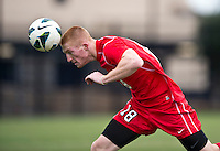 Tim Parker (18) of St. John's heads the ball back to his keeper during the game at North Kehoe Field in Washington DC. Georgetown defeated St. John's, 2-1, in the Big East conference tournament quarterfinals.