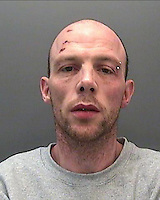 """Pictured: Police custody picture of Darren Machon<br /> Re: A burglar has been jailed after his """"novelty"""" underwear was held up in court and used as evidence against him.<br /> Darren Machon, 39, of Maesteg, had denied burgling a house in Park Street, Bridgend, in February.<br /> But a witness spotted his """"distinctive"""" boxer shorts after she saw him bent over while rummaging through cupboards, a statement from South Wales Police said.<br /> He was jailed for 34 months on Tuesday after a trial at Cardiff Crown Court.<br /> Machon was arrested for the burglary while he was in police custody for a separate offence, the police statement said.<br /> As he was getting changed in his cell, an officer noticed his underwear, which had pictures of hot dogs and doughnuts, matched those described by the witness of a burglary earlier that day."""
