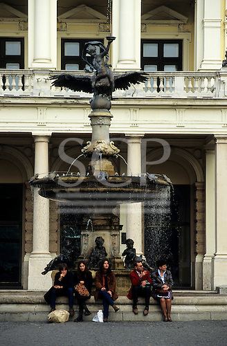 Bratislava, Slovakia. People sitting next to the fountain in front of the National Theatre.
