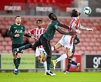 23rd December 2020; Bet365 Stadium, Stoke, Staffordshire, England; English Football League Cup Football, Carabao Cup, Stoke City versus Tottenham Hotspur; Nick Powell of Stoke City is pushed into the ball by Davison Sanchez of Tottenham Hotspur