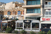 Malta, 28 December 2014<br /> <br /> The harbourfront of the Ta Xbiex and Gzira neighbourhoods opposite the old capital of Valetta. Old traditional buildings often mixed with modern glass and metal appartments waiting for the summer tourist invasion.<br /> <br /> Photo Kees Metselaar