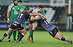 No way through for Connacht centre Craig Ronaldson as Ospreys pair Dmitri Arhip and Marc Thomas close in.<br /> Guiness Pro12<br /> Ospreys v Connacht<br /> Liberty Stadium<br /> 31.10.14<br /> ©Steve Pope-SPORTINGWALES