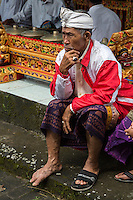 Jatiluwih, Bali, Indonesia. Old Man with One Sandal,  Luhur Bhujangga Waisnawa Hindu Temple.  He wears a sarong and an udeng, the traditional male Balinese head wrap.
