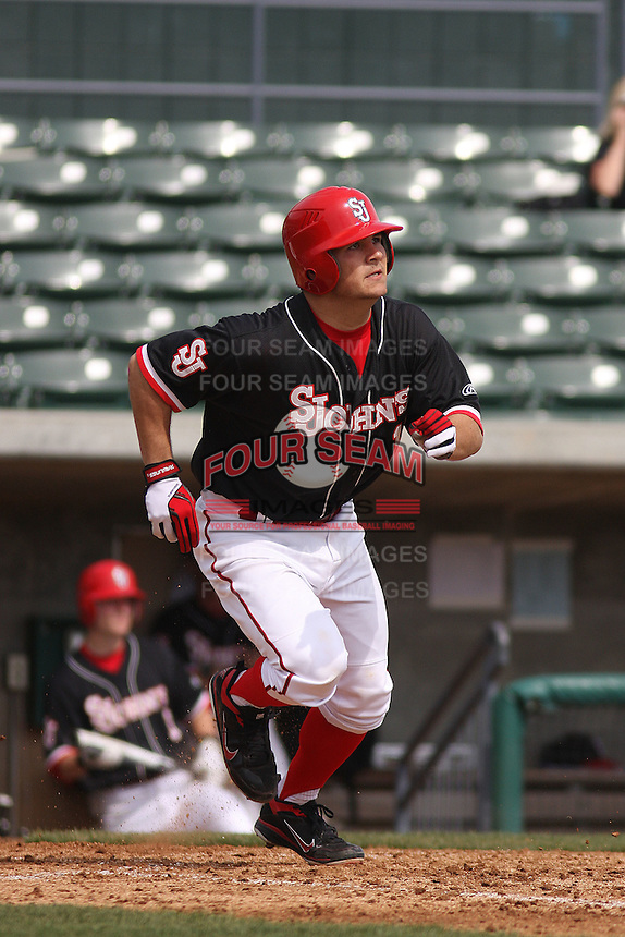 St. Johns University Red Storm 3rd baseman Zach Lauricella #13 at bat during a game against the University of Illinois Fighting Illini at BB&T Coastal Field on March 02, 2012 in Myrtle Beach, SC.  Illinois defeated St. Johns 4-0. (Robert Gurganus/Four Seam Images)