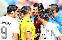 Italy goalkeeper Gianluigi Buffon goes face to face with referee Marco Rodriguez after he sent off Claudio Marchisio
