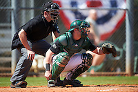 Umpire Mike Savakinas and Dartmouth Big Green catcher Adam Gauthier (18) wait for the pitch during a game against the Eastern Michigan Eagles on February 25, 2017 at North Charlotte Regional Park in Port Charlotte, Florida.  Dartmouth defeated Eastern Michigan 8-4.  (Mike Janes/Four Seam Images)