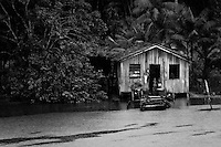 A wooden shack of a colonist's family seen on the bank of the Amazon River, Brazil, 3 March 2004. Amazonia is the world's largest dense tropical forest area. Since the 16th century the original indigenous people have been virtually pushed away or exterminated. The primal ancient unity between tribes and the jungle ambient has changed into a fight between the urban based civilization and the jungle enviroment. Although new generations of white and mestizo settlers have not become adapted to the wild tropical climate and rough conditions, they keep moving deeper into the virgin forest. The technological expansion causes that Amazonia is changing rapidly.
