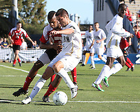 Michael Nanchoff #9 of the University of Akron is tackled by Andrew Farrell #5 of the University of Louisville during the 2010 College Cup final at Harder Stadium, on December 12 2010, in Santa Barbara, California. Akron champions, 1-0.