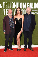 """Terry Gilliam, Olga Kurylenko and Jonathan Pryce<br /> arriving for the London Film Festival screening of """"The Man Who Killed Don Quixote"""" at the Embankment Gardens<br /> <br /> ©Ash Knotek  D3445  16/10/2018"""