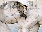 A Roman marble statue at the Vittoriano monument in Rome, Italy.
