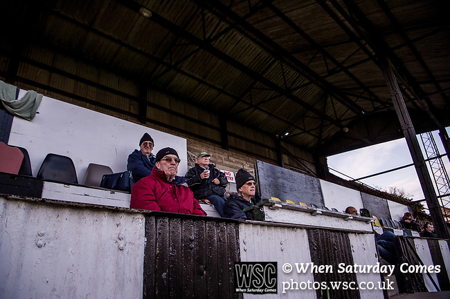 Harwich & Parkeston 2 Barnston 0, 11/11/2017. Royal Oak Ground, Andreas Carter Essex & Suffolk Border League Premier Division. Harwich & Parkeston reached the final of the Amateur Cup in 1953 at Wembley Stadium and played in front of a crowd of 100,000.  <br /> Harwich & Parkeston supporters in the main stand. Photo by Simon Gill.