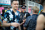 © Joel Goodman - 07973 332324 - all rights reserved . 25/08/2019. Manchester, UK. A police officer with a rainbow glitter decorated beard patrols amongst revellers in Manchester's Gay Village during the city's annual Gay Pride festival , which celebrates LGBTQ+ life and is the largest of its type in Europe . Photo credit : Joel Goodman