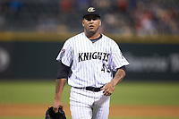 Charlotte Knights relief pitcher Gregory Infante (45) walks off the field between innings of the game against the Indianapolis Indians at BB&T BallPark on May 26, 2018 in Charlotte, North Carolina. The Indians defeated the Knights 6-2.  (Brian Westerholt/Four Seam Images)