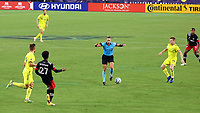 NASHVILLE, TN - SEPTEMBER 23: Referee Tori Penso jumps to avoid the ball during a game between D.C. United and Nashville SC at Nissan Stadium on September 23, 2020 in Nashville, Tennessee.