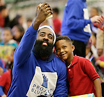 Houston Rockets player James Harden takes a selfie with a student at Crespo Elementary school.