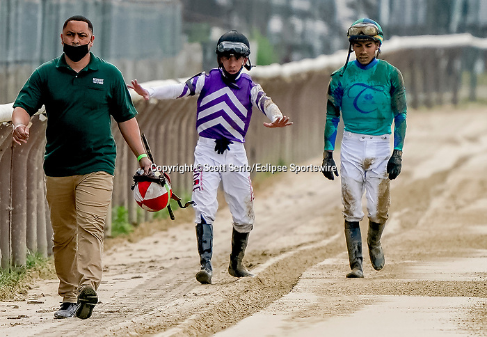June 3, 2021: Jockey Junior Alvarado gives Jose Ortiz a play by play of trying to avoid jockey Ortiz's brother Irad as he was on the ground after his horse stumbled during an undercard race Thursday at the Belmont Stakes Festival at Belmont Park in Elmont, New York. Irad Ortiz's valet is carrying his helmet as the rider was transported to a nearby medical facility for treatment and evaluation. The horse, Equal Pay, was unharmed. Scott Serio/Eclipse Sportswire/CSM