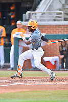 Tennessee Volunteers right fielder Justin Ammons (9) swings at a pitch during a game against the University of North Carolina Greensboro (UNCG) Spartans at Lindsey Nelson Stadium on February 24, 2018 in Knoxville, Tennessee. The Volunteers defeated Spartans 11-4. (Tony Farlow/Four Seam Images)