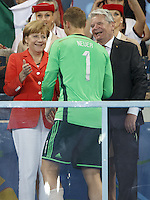 Chancellor of Germany Angela Merkel and President of Germany Joachim Gauck congratulate Goalkeeper Manuel Neuer of Germany