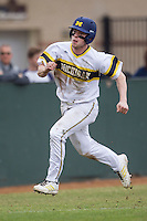 Michigan Wolverines shortstop Travis Maezes (9) heads home during the NCAA baseball game against the Washington Huskies on February 16, 2014 at Bobcat Ballpark in San Marcos, Texas. The game went eight innings, before travel curfew ended the contest in a 7-7 tie. (Andrew Woolley/Four Seam Images)