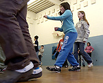SEYMOUR, CT. 03 January 2008-010308SV04--Chatfield Elementary School students, from left, Kayla Colagiovanni, 9, and Rebecca Flodquist, 10, both of Seymour dance with other 4th grade students from Washington Elementary School from West Haven at their school in Seymour Thursday. The two schools were having an exchange day where they spend the day together at the school.<br /> Steven Valenti Republican-American