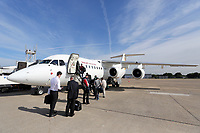 Wednesday 07 August 2013<br /> Pictured: Swansea City FC staff boarding the aeroplane at Cardiff Airport.<br /> Re: Swansea City FC travelling to Sweden for their Europa League 3rd Qualifying Round, Second Leg game against Malmo.