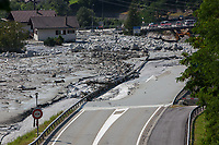 Switzerland. Canton Graubunden. Bregaglia valley. Bondo. The remote village was hit by a huge landslide caused by a giant rockslide swept down from Piz Cengalo on August 23, 2017. The mudslide smash the carpentry factory and several barns. The road had to be closed to traffic. Four police cars and police officers are on duty to prohibit people to enter the village and to ensure safety. 25.08.2017 © 2017 Didier Ruef