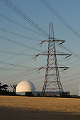 Electricity pylon and the dome of the pressurised water reactor at Sizewell B nuclear power station, Suffolk.