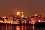 Moonset on the Boston waterfront, Boston, Massachusetts, USA