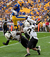 Pitt wide receiver Aaron Mathews (6) hurdles UCF defensive backs Antwan Collier (3) and Tay Gowan (23). The Pitt Panthers defeated the UCF Knights 35-34 in a football game played at Heinz Field, Pittsburgh, Pennsylvania on September 21, 2019.