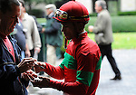 09 October 09: Jockey Garrett Gomez signs an autograph for a fan in the grandstand tunnel on opening day of the fall meet at Keeneland in Lexington, Kentucky.
