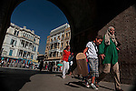 Locals walk past the gate to the Medina in Tunis. This World Heritage site was erected in the 7th century and has been the focal point of the city until the French arrived and built the Ville Nouvelle. <br /> September 5, 2013.