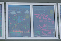 Friday March 9, 2007   ----  Encouraging signs drawn on the school windows welcomes mushers at Shageluk